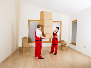 Movers in new house with lot of boxes.
