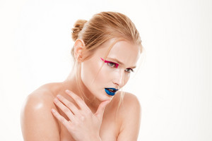 Mystery woman with hand near face looking away. Color make up