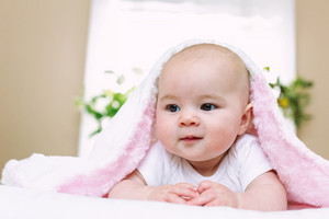Newborn baby girl on her blanket at home