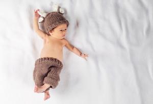 Newborn infant baby boy lying on a blanket