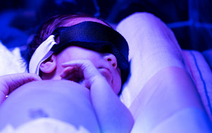 Newborn infant baby boy receiving phototherapy for jaundice at the hospital