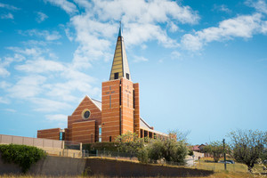 Newly built in 2005 after a tornado demolished the original one St Patrick's Catholic Cathedral stands on the hill in Bunbury Western Australia on a cloudy afternoon in late autumn.