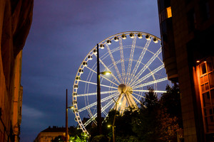 Night view of Sziget Eye, Budapest's ferris wheel in Elisabeth Square - tourism, travel, amusement concept