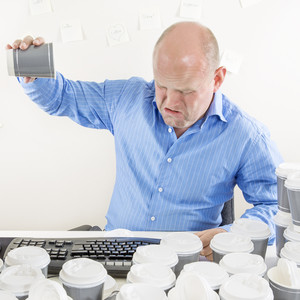 No more coffee for exhausted businessman