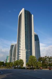 Office building on blue sky background.