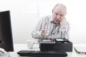 Office worker / businessman with lose computer cables.