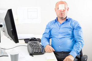 Office worker with note in the face