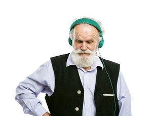 Old active bearded man with headphones listening to music isolated on white background