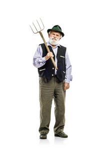 Old bearded bavarian man in hat holding pitchfork in his hand, isolated on white background