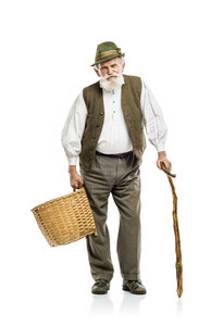 Old bearded farmer man in hat holding basket, isolated on white background