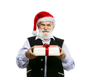 Old bearded man in santa hat holding Christmas gift isolated on white background