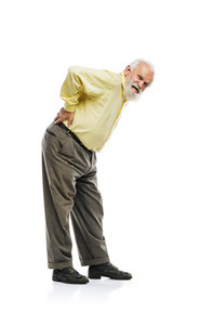 Old bearded man suffering from back pain isolated on white background