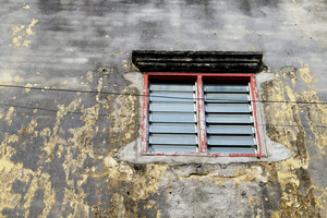 old dirty window on old dirty wall