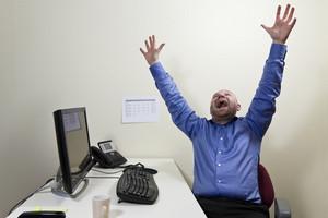 One happy businessman at work.