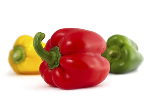 Organic and fresh red, green and yellow pepper on white background.