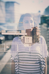 overlap young beautiful brunette woman in the city