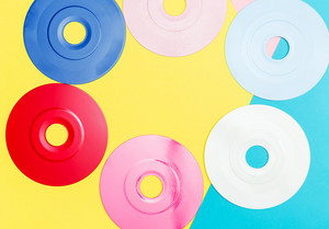 Painted vinyl records on a bright split tone background