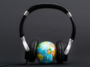 Pair of headphones listening to the world