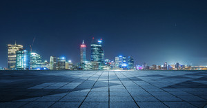 Panoramic skyline and buildings with empty concrete square floor,night scene