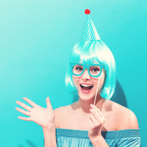 Party theme with a woman in a bright blue wig
