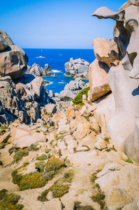 Path betweeen bizarre granite rock formations in Capo Testa, Sardinia, Italy