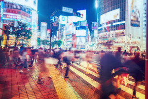 People and vehicles cross the famously busy Shibuya intersection in Tokyo