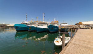 PERTH, AUSTRALIA - November 5, 2016 : Fishing boats/ships in harbour in Fremantle with the reflection on water .