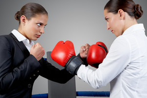 Photo of aggressive business women fighting with each other