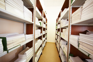 Photo of bookshelves of modern library in college or other educational institution