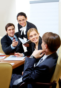 Photo of business group having hot discussion during seminar