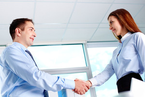 Photo of business partners handshaking after striking deal