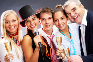 Photo of businesspeople with flutes of champagne celebrating Christmas