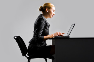 Photo of pretty secretary typing on laptop at workplace
