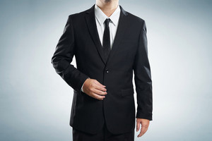 Photo of stylish man in elegant black suit  , with clipping path