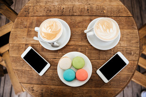 Photo of table in a cafe. coffee. phone.