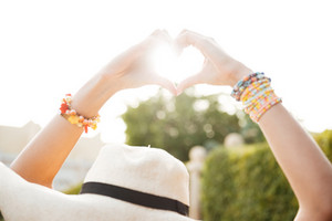 Photo of Woman hands which showing heart gesture