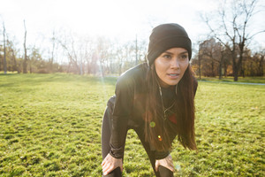 Picture of female runner in warm clothes and earphones in autumn park