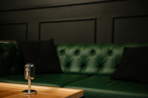 Picture of retro microphone against restaurant background with sofa