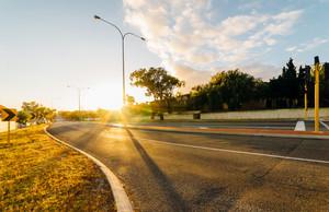 Picturesque street scene and sunrise above road ,Fremantle, Western Australia.