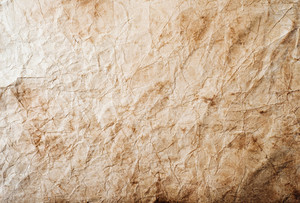Piece of old rumpled stained paper as background, empty copy space