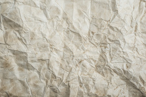 Piece of old rumpled stained paper as background