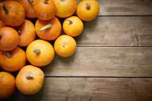 Pile of orange pumpkins on wooden table