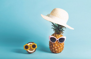 Pineapple and coconut with sunglasses and summer themed objects