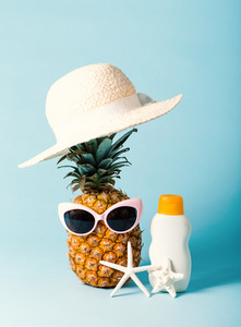 Pineapple with sunglasses and summer themed objects