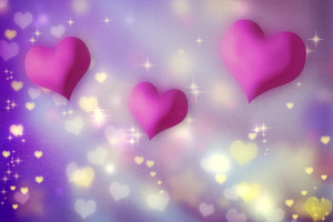 Pink and magenta hearts on purple background