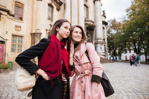 Portraif of two fashion friends. in coats