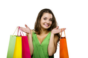 Portrait of a beautiful young woman posing with shopping bags, isolated on white background