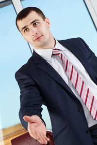 Portrait of a businessman stretching his hand for a handshake