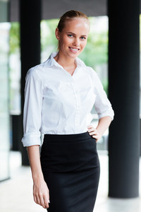 Portrait of a businesswoman standing with hand on hips outdoors