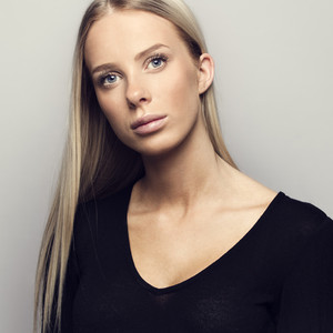 Portrait of a casual blonde woman in black top